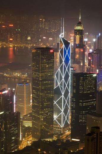 Hong Kong´s modern skyline overlooking Victoria harbour and Kowloon peninsula at night, Hong Kong, China : Stock Photo