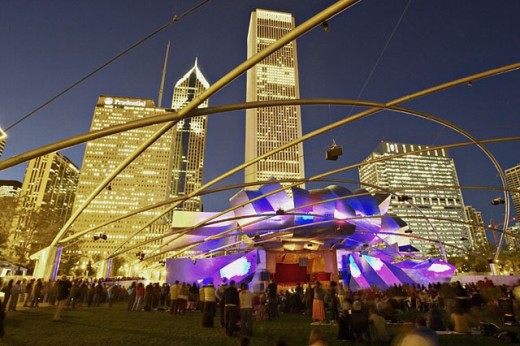 Stock Photo: 1566-268038 Pritzker Pavilion in Millennium Park, entertainment and music venue, Frank Gehry modern architecture, audience, Great Lawn. Chicago. Illinois. USA.