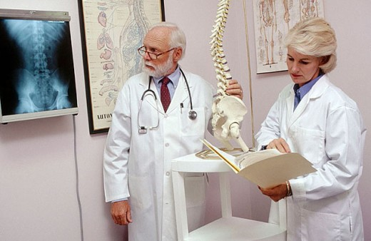 two doctors examine a spinal xray : Stock Photo