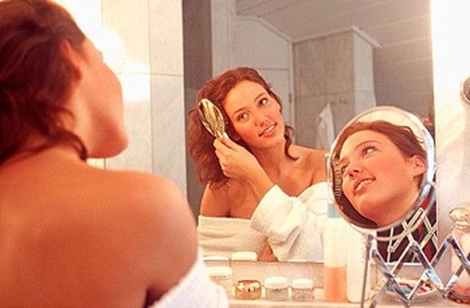 Stock Photo: 1566-273562 Woman brushing hair