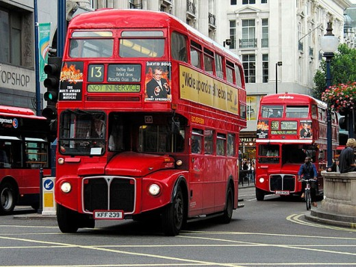 Stock Photo: 1566-279402 Double-decker red buses, Oxford Circus, London. England, UK
