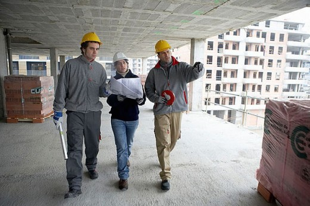 Stock Photo: 1566-280894 Workers with blueprints and tools. Housing construction, apartments. San Sebastian, Gipuzkoa, Euskadi. Spain.