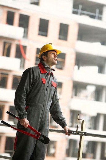 Worker with working clothes and pliers. Housing construction, apartments. San Sebastian, Gipuzkoa, Euskadi. Spain. : Stock Photo