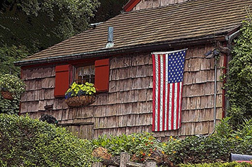 Stock Photo: 1566-284729 American Flag draped on the side of an historic home, at Independence Day USA Holiday, July 4th. New York. USA.