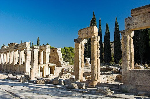 The ruins of columns and buildings on Frontinus Street in Hierapolis, Turkey. : Stock Photo