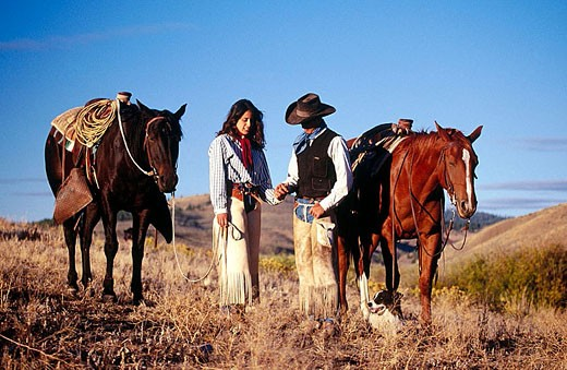 Stock Photo: 1566-285141 Cowboy and cowgirl. Ponderosa Ranch. Seneca. Oregon . USA