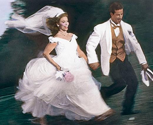 Wedding couple running into future : Stock Photo