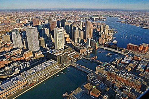 Boston with Fort Point in the foreground. US Postal Facility in lower left corner and Mystic River Bridge (green) in background. Boston´s inner harbor on right. Boston, Massachusetts. USA. : Stock Photo