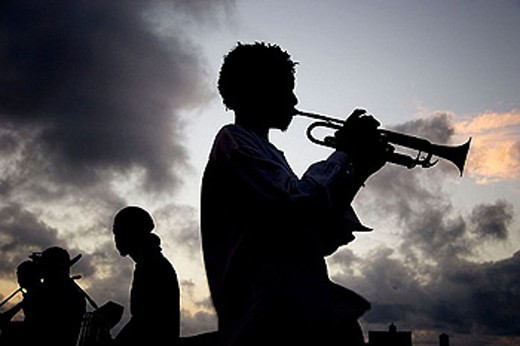 Stock Photo: 1566-287718 Trumpet player in El Malecón in the evening. Havana. Cuba