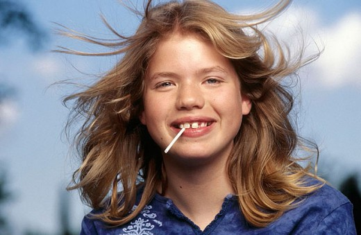 Stock Photo: 1566-288146 Headshot of Adolescent girl with Lollipop.