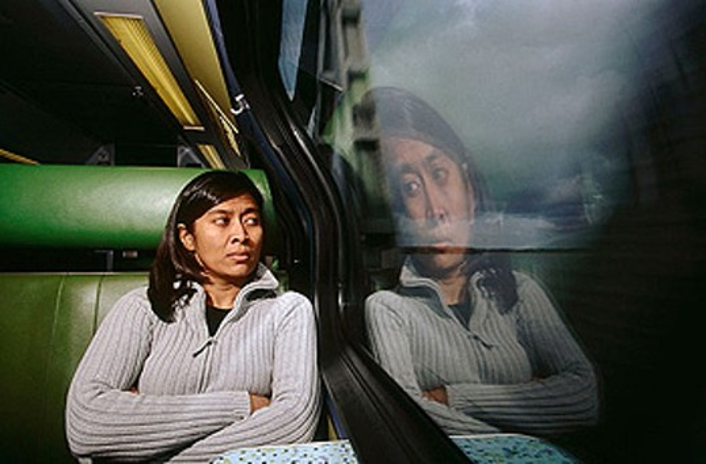 Asian woman on commuter train : Stock Photo
