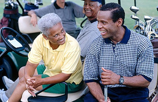 smiling golfers chatting : Stock Photo