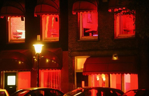 Window prostitutes in the red light district, Amsterdam. Holland : Stock Photo