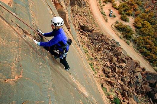 Stock Photo: 1566-292807 Female climber on route at the Ice Cream Parlor crag near Moab, Utah, USA