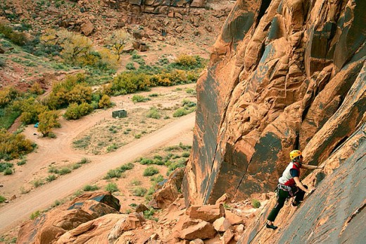 Stock Photo: 1566-292808 Female climber on route at the Ice Cream Parlor crag near Moab, Utah, USA