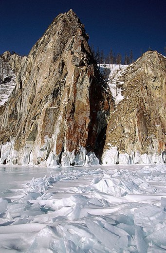 Granite cliffs and frozen Baikal lake, Siberia, Russia : Stock Photo
