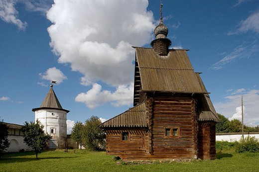Stock Photo: 1566-295880 Monastery of Archangel Michael founded in the 13th century: wooden church of St. George (1718) and Holy Gate (1654), Gateway-church of St. John (1670), Yuriev Polskoy. Golden Ring, Russia