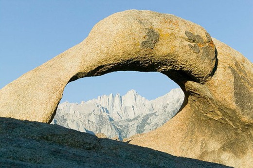 Stock Photo: 1566-296108 Mount Whitney viewed through natural stone arch in the Alabama Hills. Eastern Sierras. Bishop. California. United States