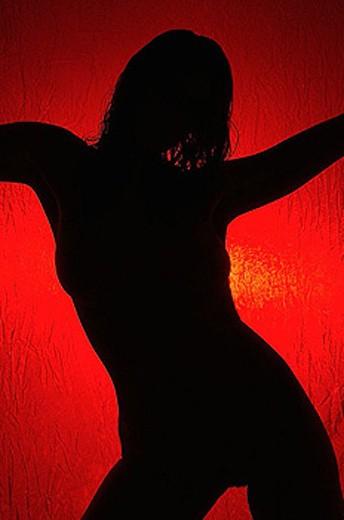 Stock Photo: 1566-296473 female torso silhouette,lighten red background