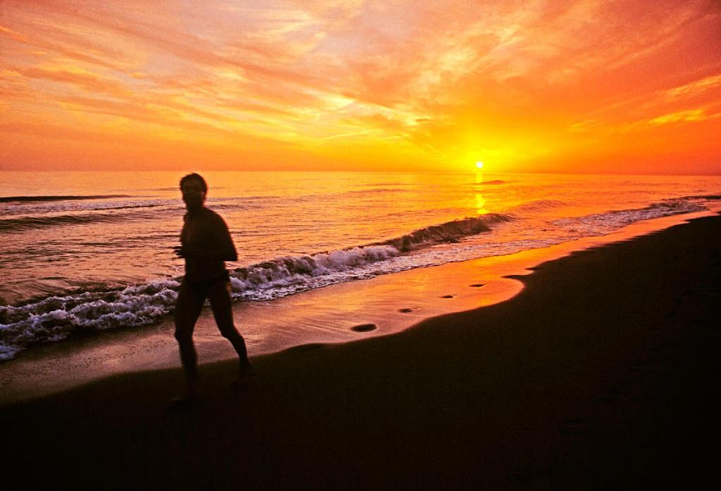 Evening jogging in Playa de las Dunas. Marbella. Malaga-province. Costa del Sol. Andalucia. Spain. : Stock Photo