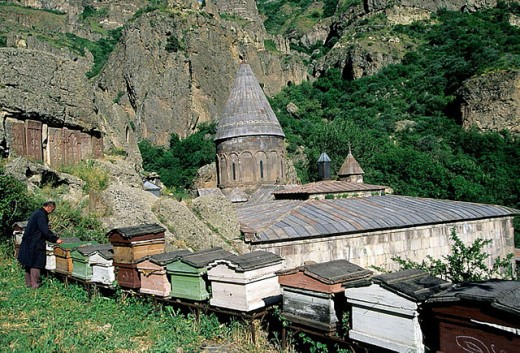 Geghard monastery complex and beehives at fore. Armenia : Stock Photo
