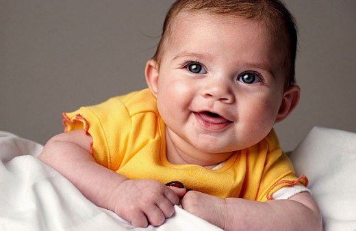 Little baby smiling in studio : Stock Photo
