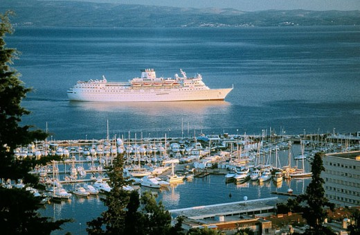 Stock Photo: 1566-305050 Cruise ship sails throught Splitski channel as viewed from Marjan Hill, Split. Croatia