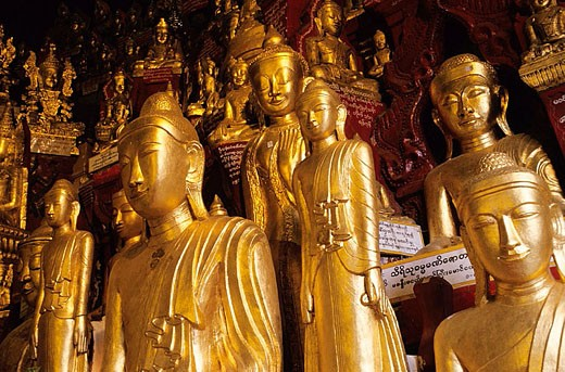 Golden Buddha statues at the entrance of Pindaya cave. Myanmar : Stock Photo