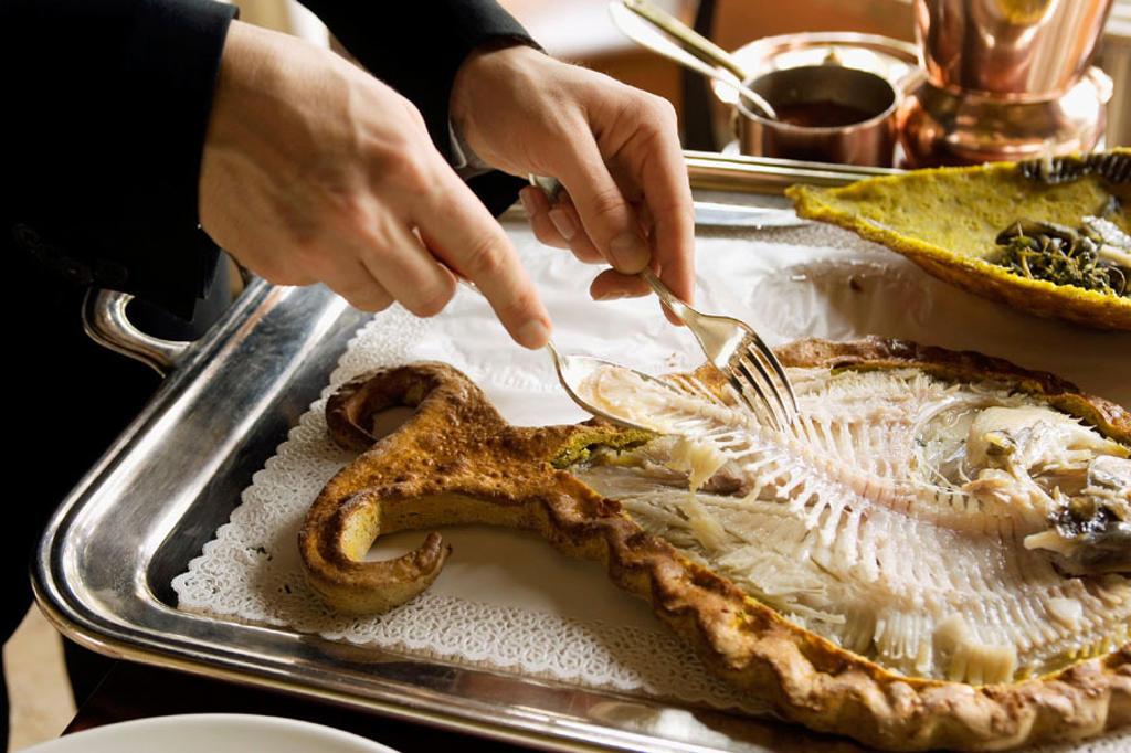 L´Albereta. Gualtiero Marchesi Restaurant. Serving the ´Rombo in Crosta di Sale´. Erbusco, province of Brescia, in Lombardy. : Stock Photo