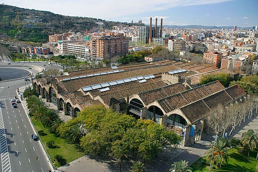 Stock Photo: 1566-317501 Drassanes (Old dockyards). Gothic style, XIIIth century. Maritime Museum. Passeig Josep Carner façade. Poble Sec in background. Barcelona. Catalonia. Spain.