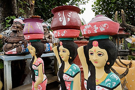 Stock Photo: 1566-319935 Kitsch cement sculptures along the road to Tabanan. Traditional balinese art is gradually replaced by poor industrial items. Island of Bali. Indonesia