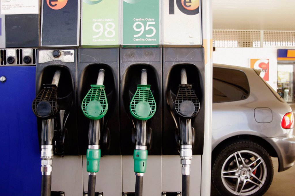 Stock Photo: 1566-322431 Petrol pumps and car in the back.