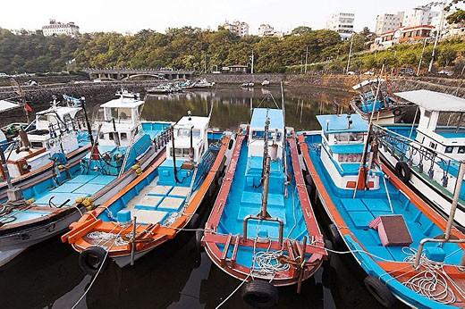 Fishing boats equiped with powerful lights to attract squid at night, Seogwipo harbor, Jeju-Do, South Korea : Stock Photo