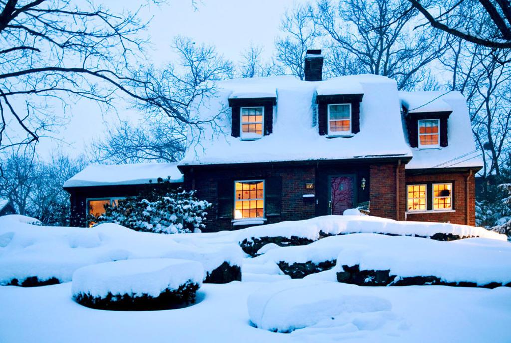 Suburban home at dusk immediately after snowstorm. Boston. Massachusetts. USA : Stock Photo