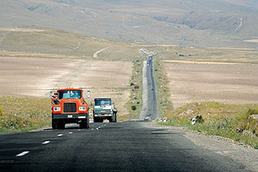 Trucks from Iran drives through Armenia on road M12. : Stock Photo