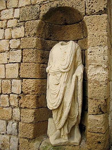 Stock Photo: 1566-328282 Headless statue at the main gate, old part of town, Ibiza, Spain
