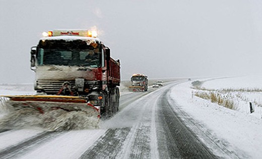 Clearing the roads for snow in a snowstorm, to keep the traffic moving. Jutland, Denmark, Scandinavia. : Stock Photo