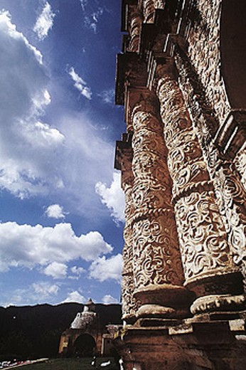 Columns of Santo Domingo Temple façade. The construction of the convent began in 1547. Baroque façade made of mortar from the XVIIth century with Oaxaca and Guatemala styles influences. Mexico. : Stock Photo