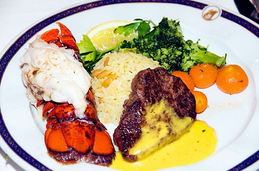 A Surf and Turf dinner special of steak and lobster on the Holland America cruise ship MS Zuiderdam. : Stock Photo