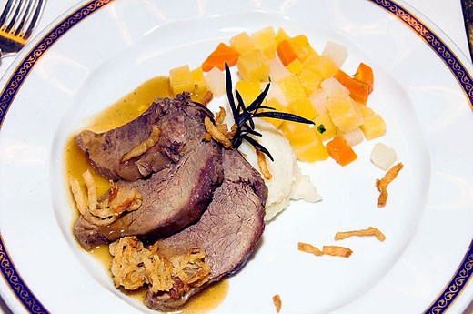 Stock Photo: 1566-330989 Beef tenderloin dinner plate with mini squares of vegetables served on the Holland America cruise ship Zuiderdam.