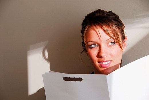 20 yr old young woman holding file folder : Stock Photo