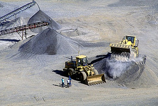 Stock Photo: 1566-334633 Bulldozers in rock quarry.