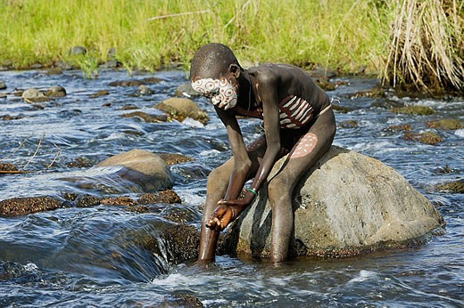 Make-up. Surma child. Near Kibish. Ethiopia. : Stock Photo