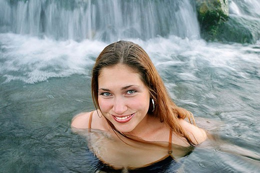 Stock Photo: 1566-336618 Young Russian woman enjoying hot springs in Yellowstone National Park, Wyoming. USA.
