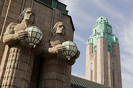 Stock Photo: 1566-338207 Lantern carriers colossal statues in front of Central Railway Station. Helsinki. Finland