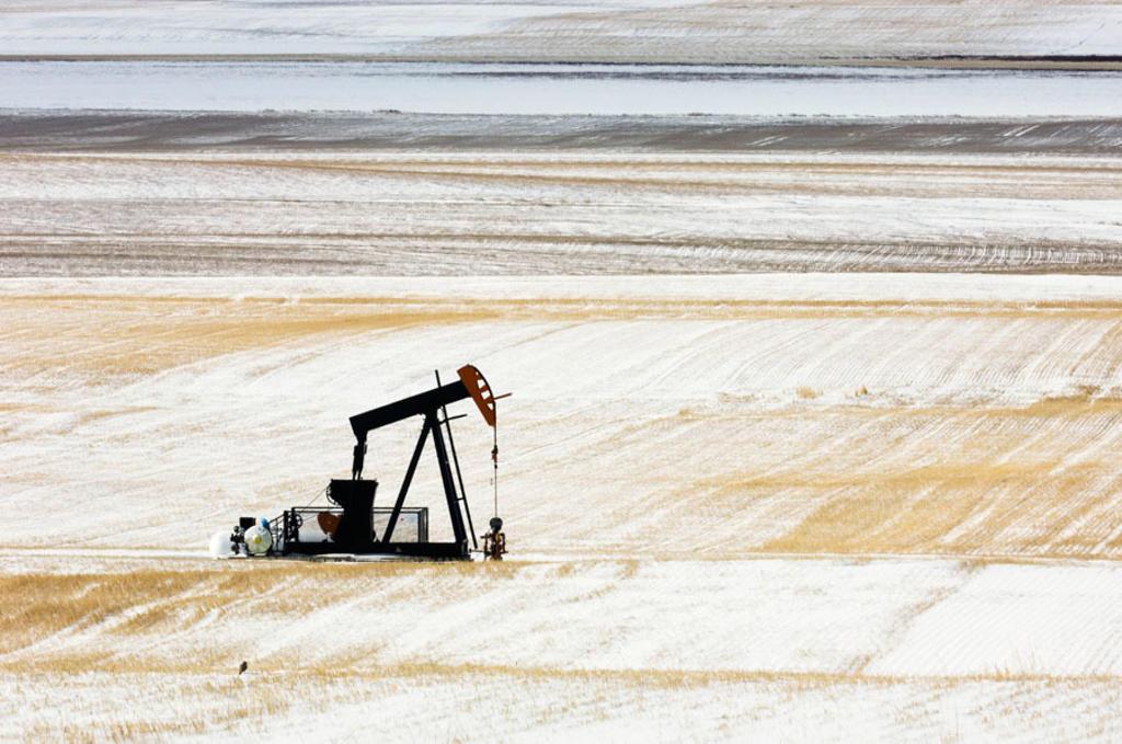 Stock Photo: 1566-338859 Oil well pump ´jack´ in snowy prairie. Alberta, Canada