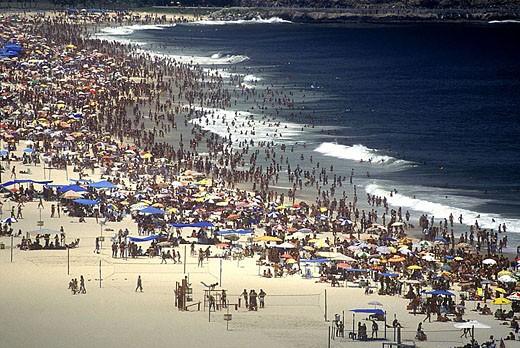 Crowd copacabana beach, Rio de Janeiro, Brazil. : Stock Photo