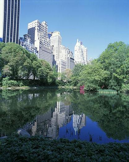Stock Photo: 1566-342520 Spring, Pond, Central park south skyline, Manhattan, New York, USA.