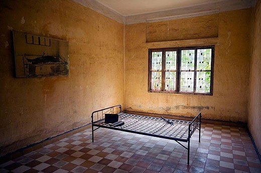 Cell where Khmer Rouge interrogated and murdered prisoners. Toul Sleng Genocide Museum. Phnom Penh. Cambodia : Stock Photo