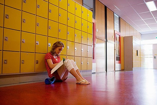 Girls is making homework in the hallway. : Stock Photo